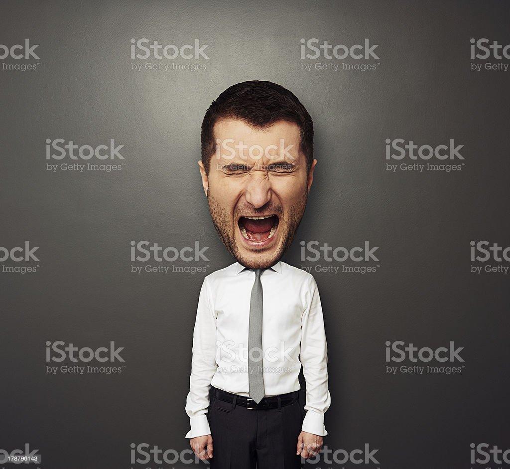 photo of bighead screaming man stock photo