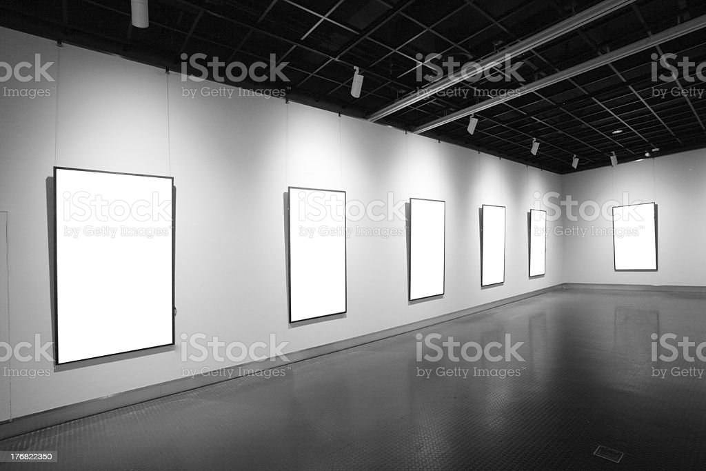 An art gallery with white paintings, perspective, simmetric.