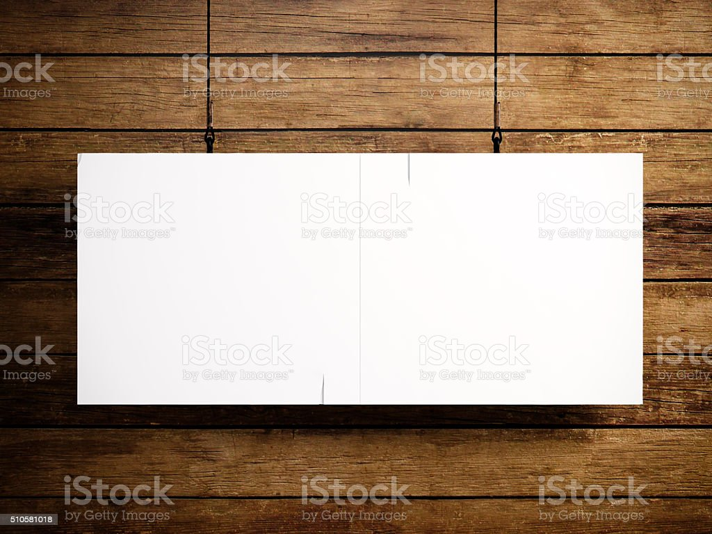 Photo of blank white canvas hanging on the wood background stock photo