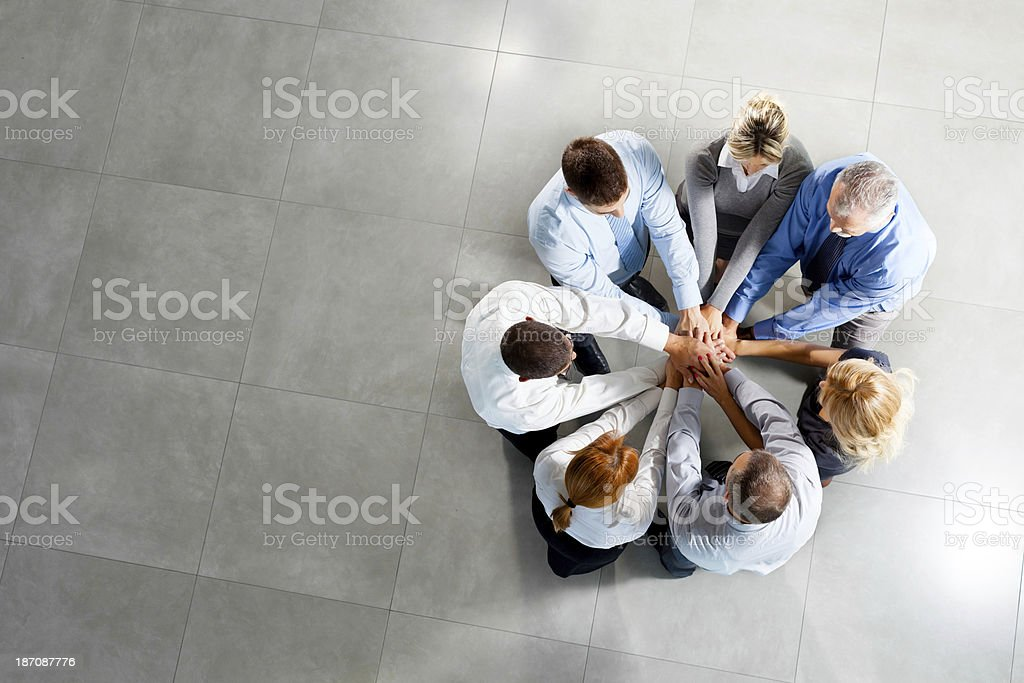 Photo of business people with hands on top stock photo