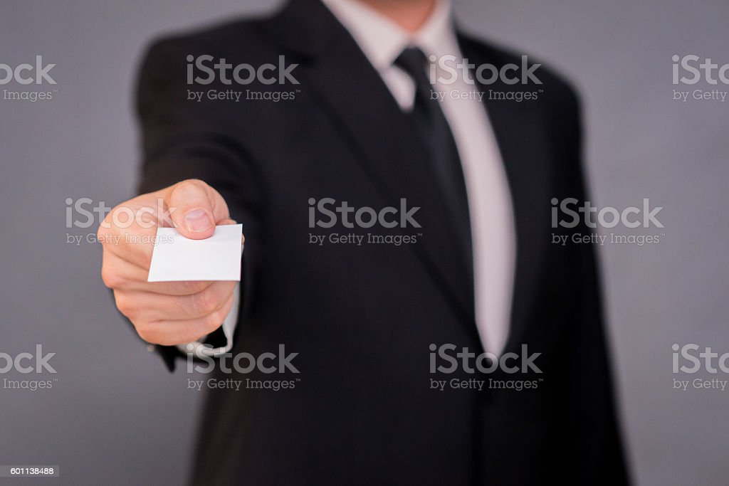 Photo of Businessman hand holding a business card stock photo