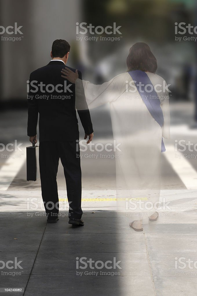 Photo of businessman walking with ghost of Jesus stock photo