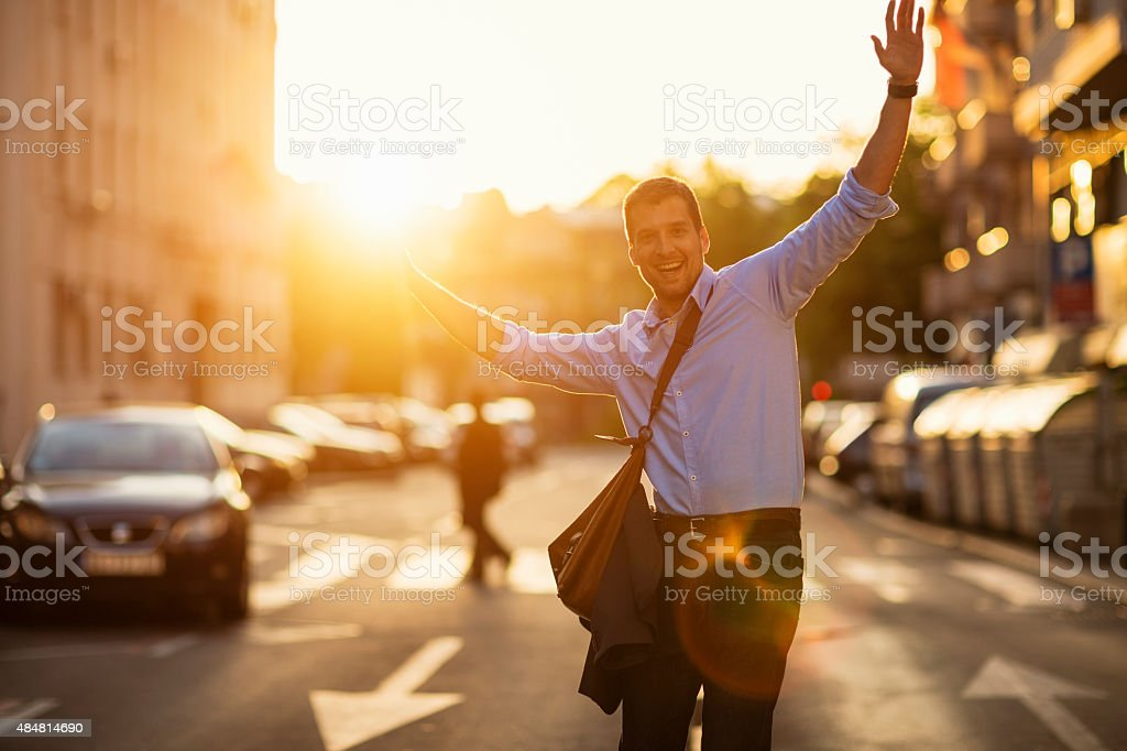 Photo of cheerful man walking with arms outstretched stock photo