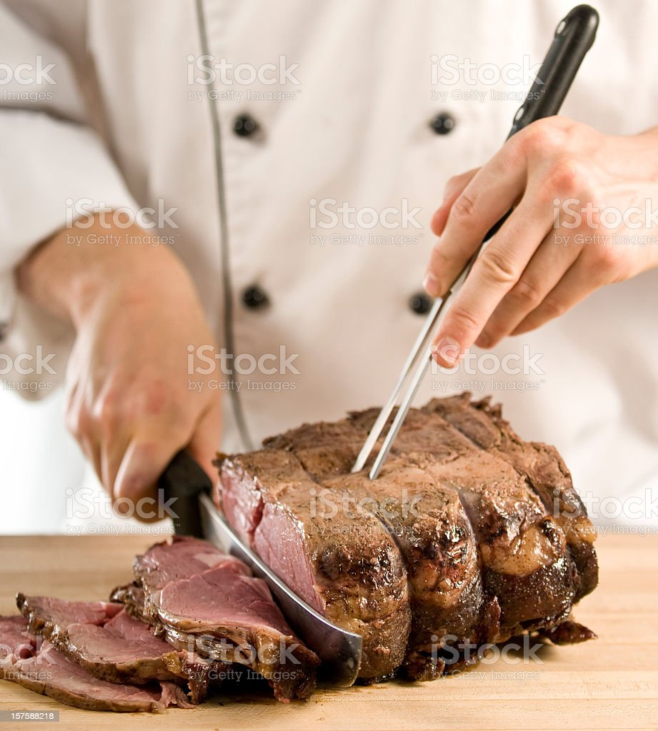 Photo of chef carving roast meat  stock photo