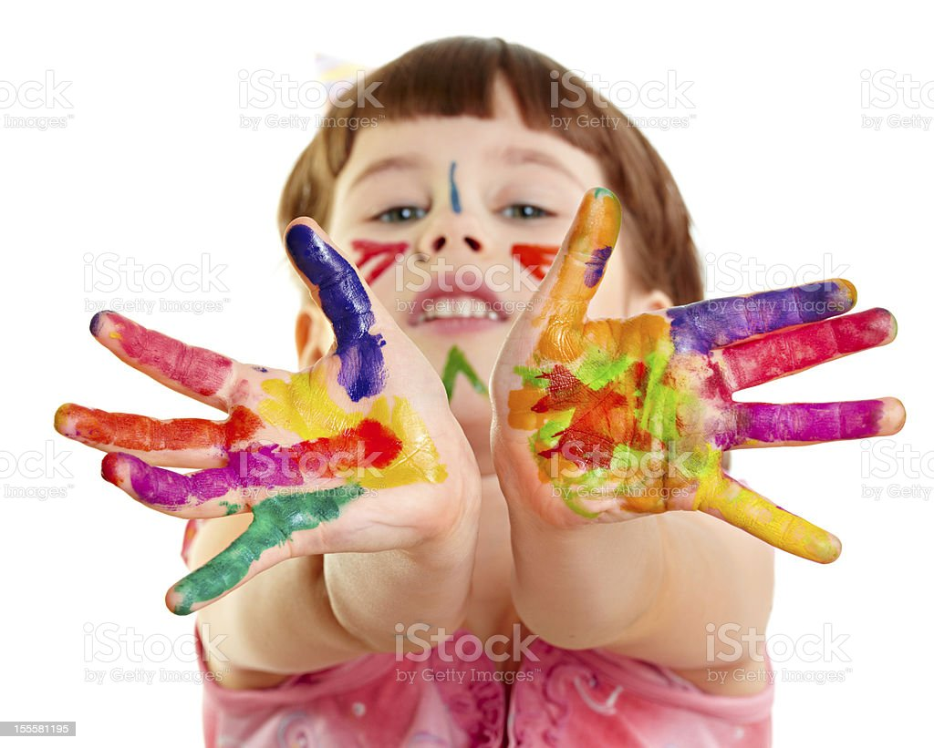 Photo of child with outstretched paint colored hands stock photo