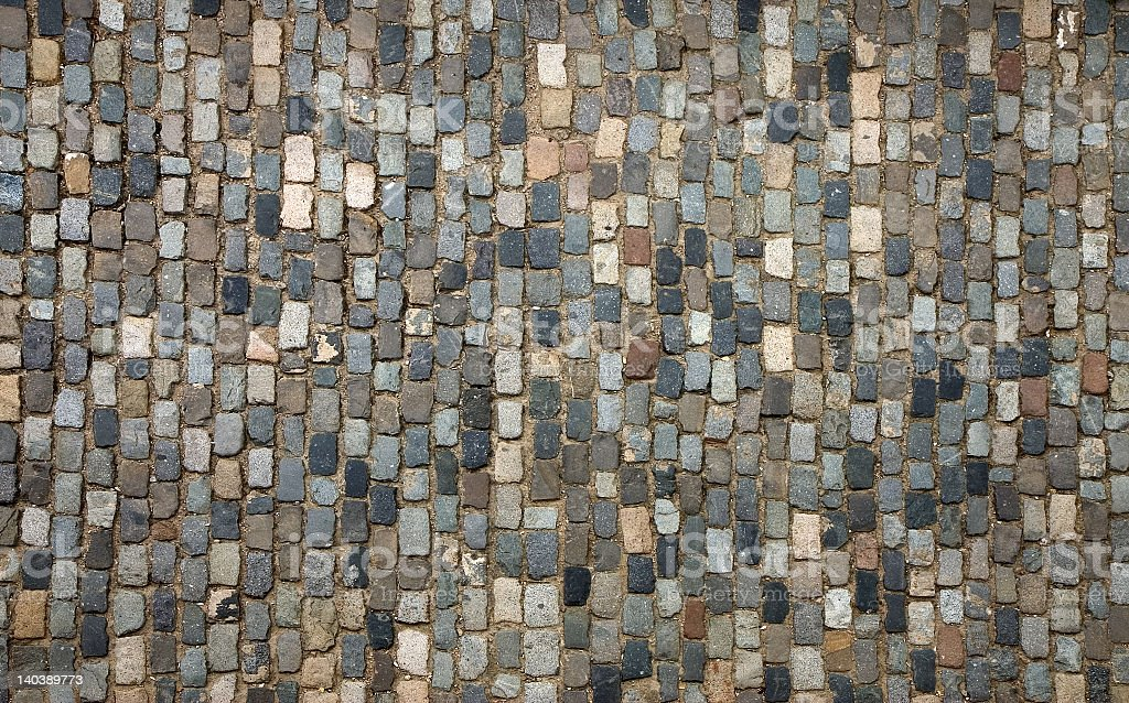 Photo of cobblestone pavement various colored cobblestones stock photo