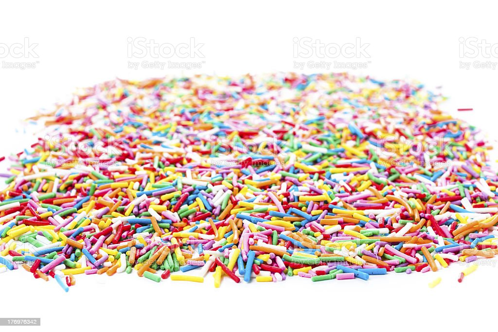 Photo of Colorful candy sprinkles isolated on white background stock photo