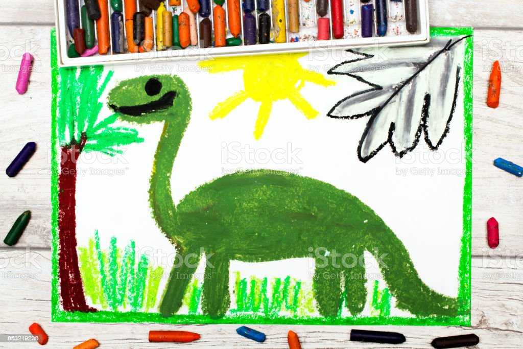 Photo of colorful drawing: Smiling dinosaur. Big green diplodocus stock photo
