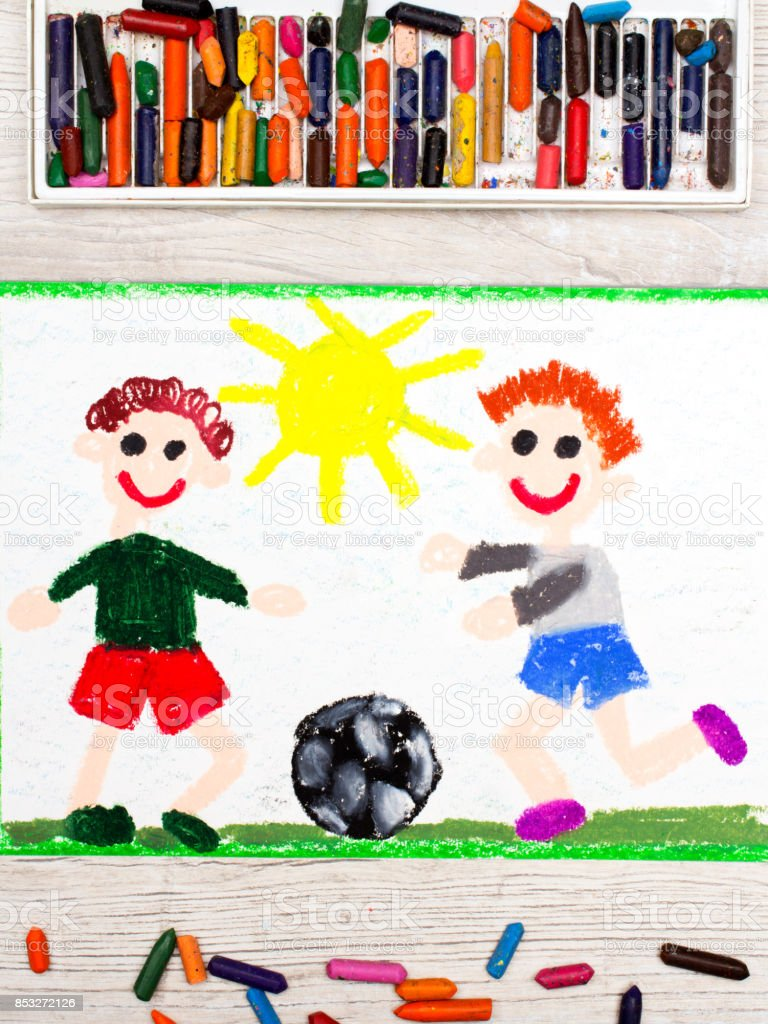 Photo of colorful drawing : Two little boys play football. Soccer game stock photo