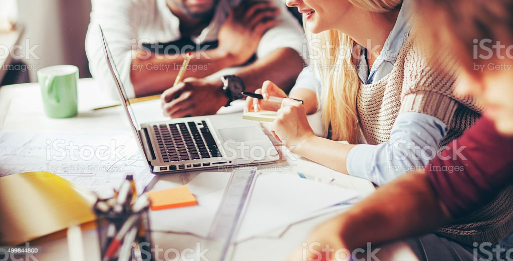Photo of designers in good mood working together stock photo