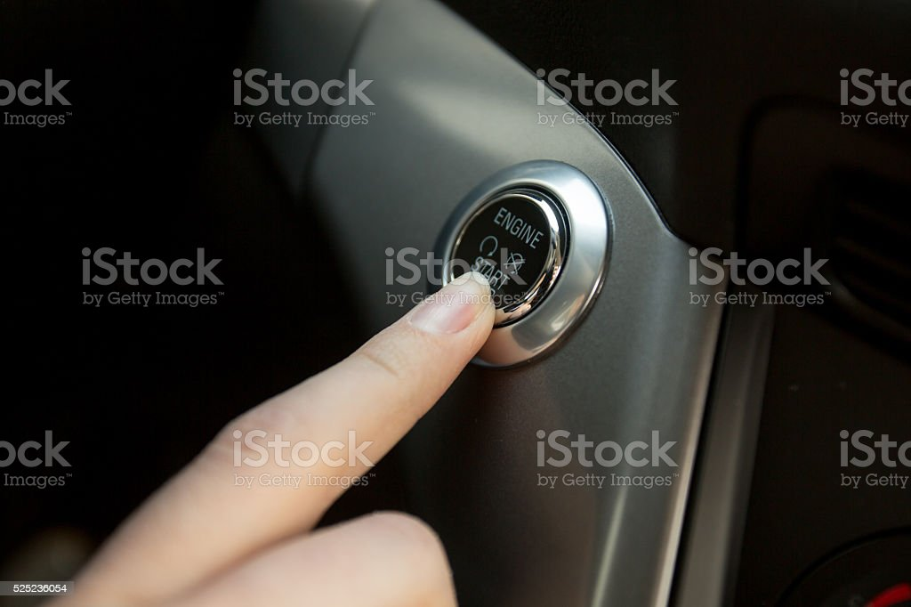photo of driver starts the engine by pressing button stock photo
