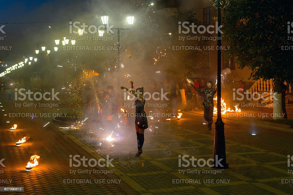 Photo of fire performance on the city street. stock photo