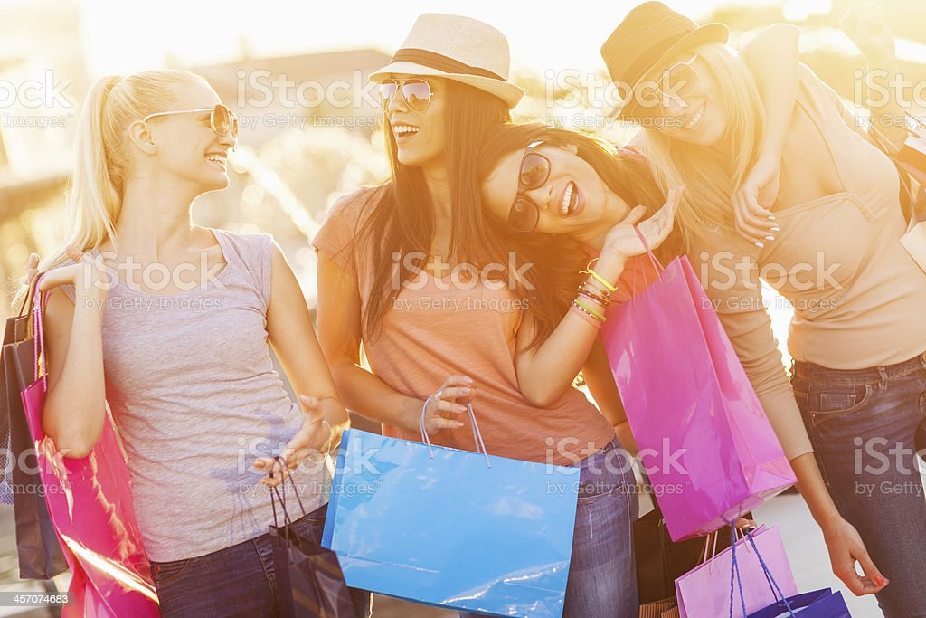 Photo of four happy friends shopping royalty-free stock photo