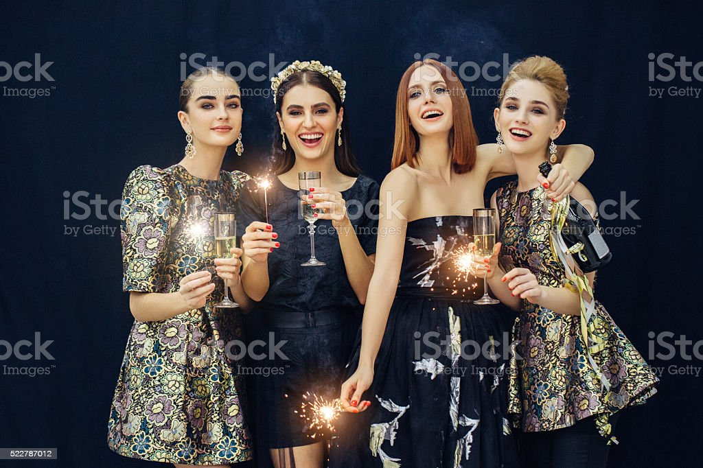 Photo of four laughing girls stock photo