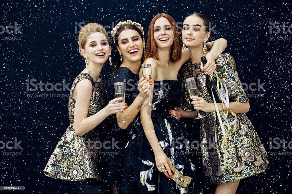 Photo of four laughing girls strewn snow stock photo
