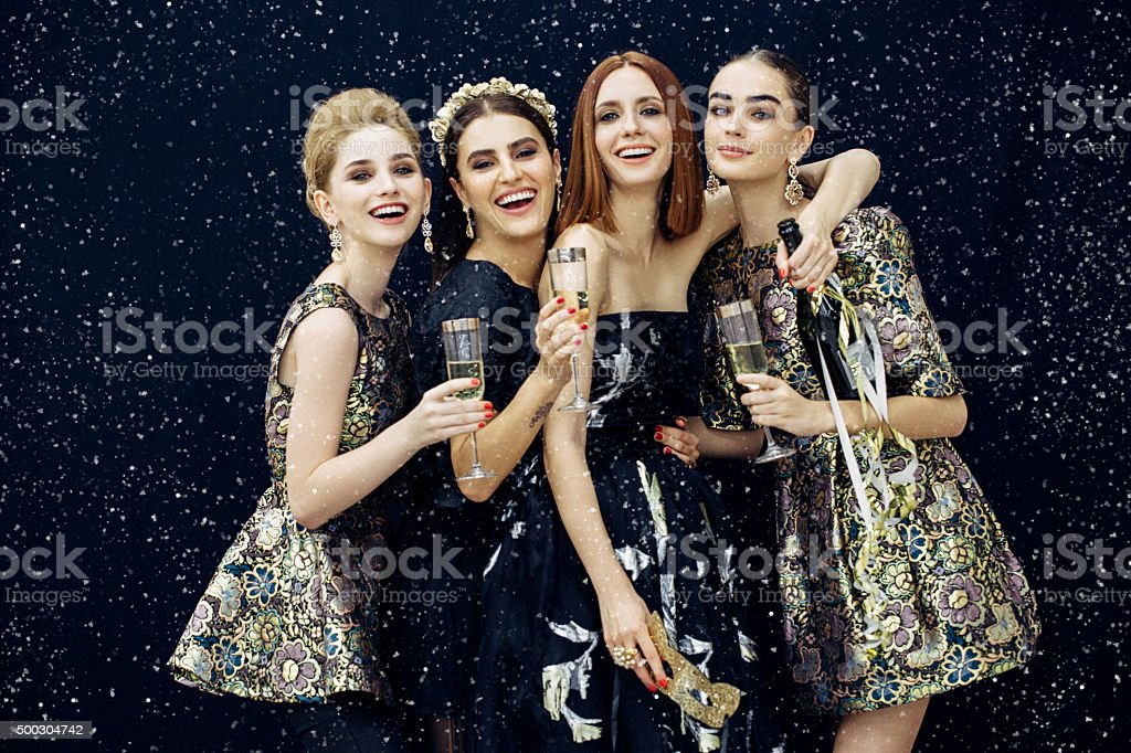 Photo of four laughing girls strewn snow stock photo