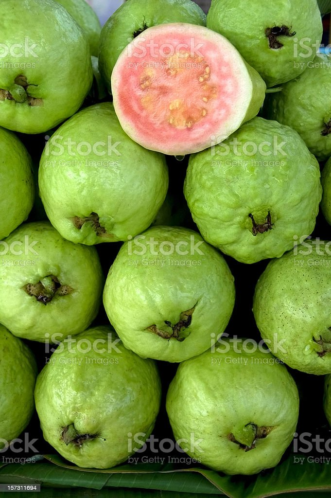 Photo of fresh guavas with one cut in half stock photo