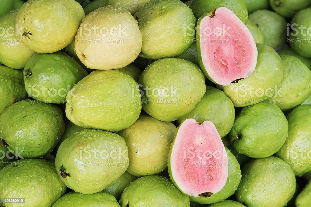 A photo of fresh red guavas, a typical tropical fruit stock photo