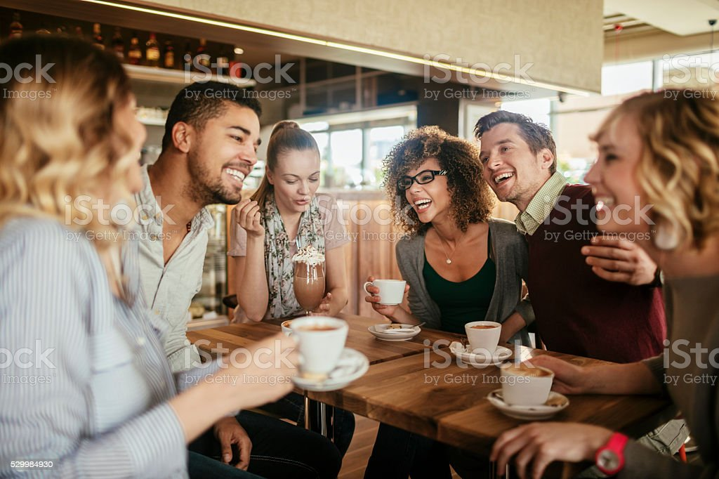 Photo of friends having coffee in cafe stock photo
