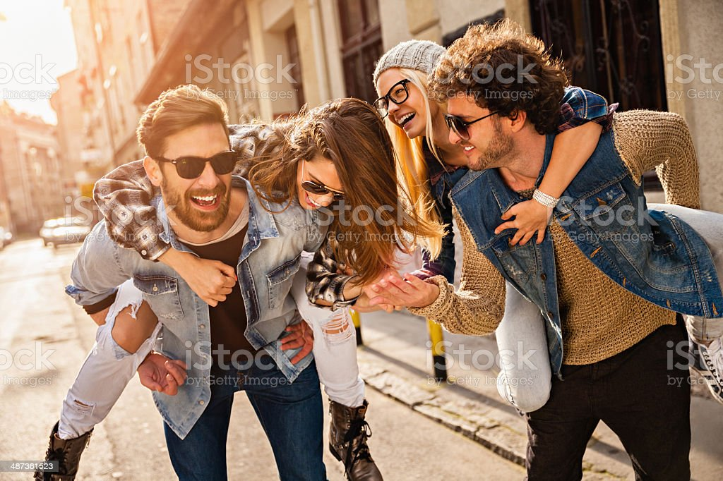 Photo of friends having fun in city stock photo