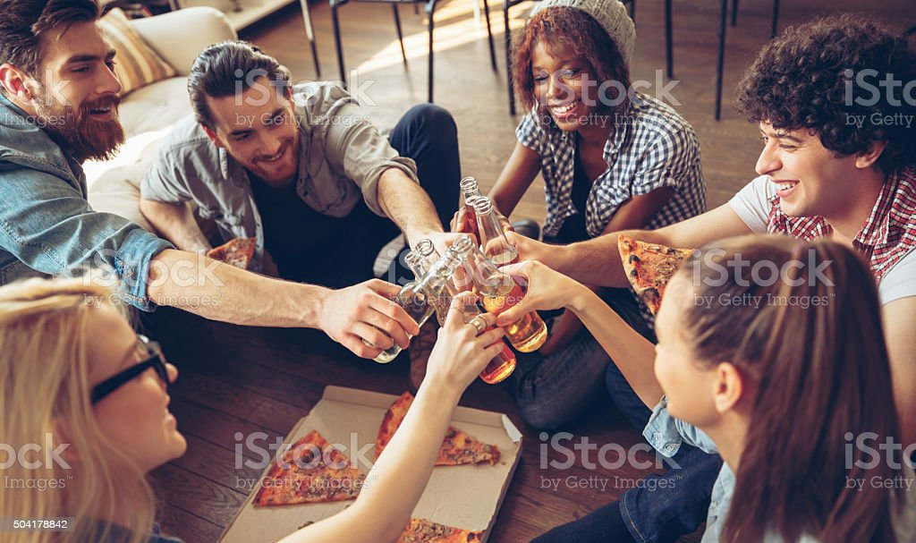 Photo of friends toasting with beerbottles stock photo