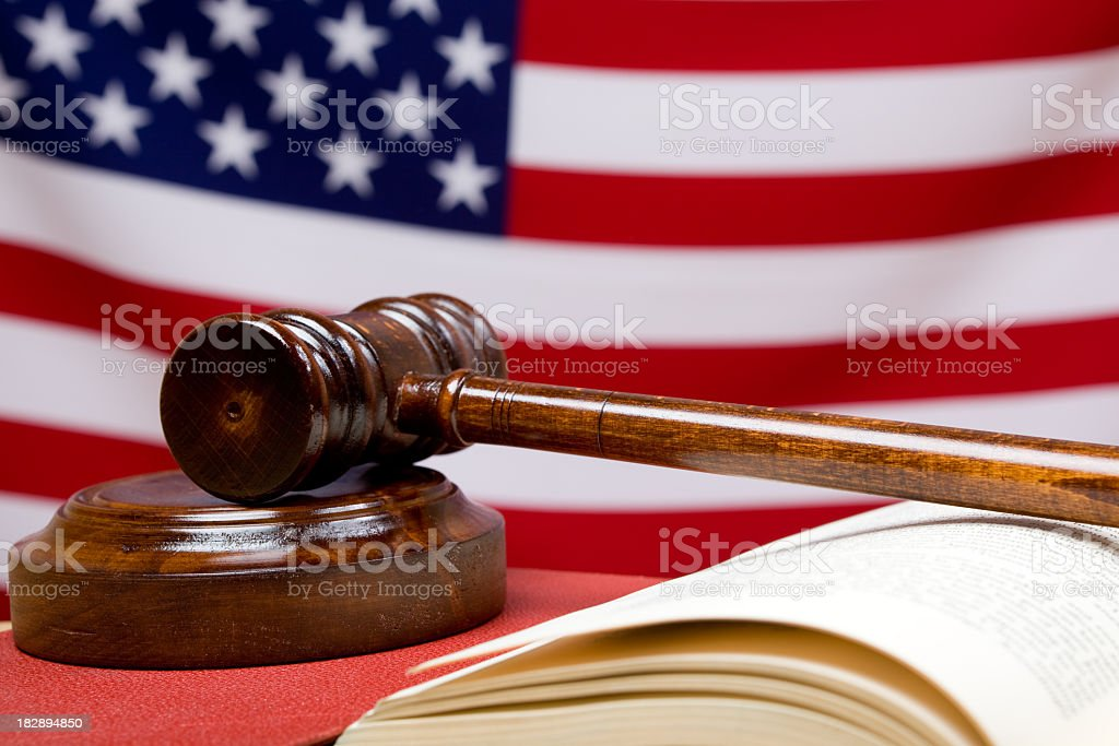 Photo Of Gavel, Book, And American Flag In The Background stock photo