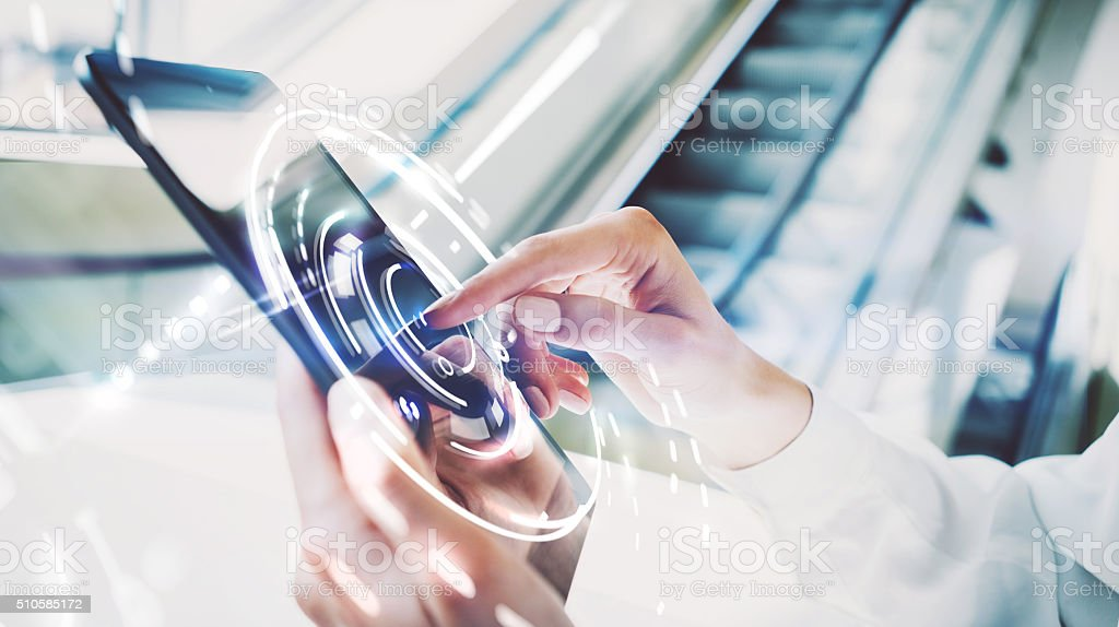Photo of girl touching screen Of tablet, visual interfaces effects stock photo