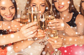 photo of girls celebrating new year party and clinking