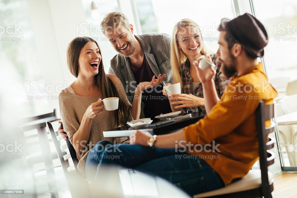 Photo of good friends having coffee together in cafe stock photo