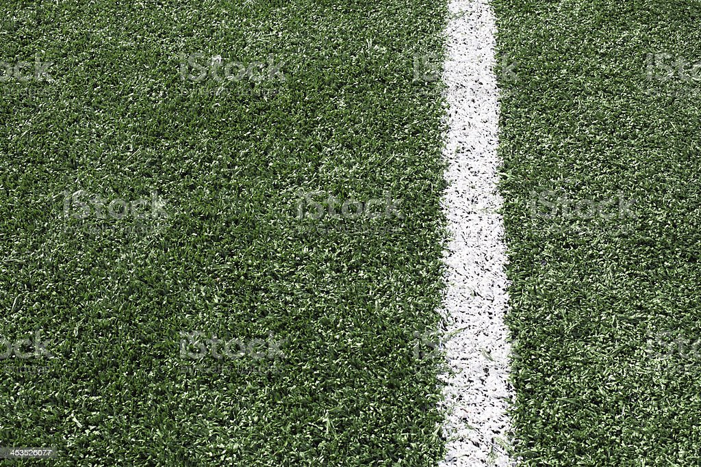 Photo of green synthetic grass sports field with white line royalty-free stock photo