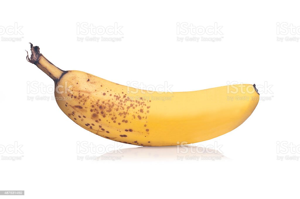 Photo of half retouched banana on white background stock photo