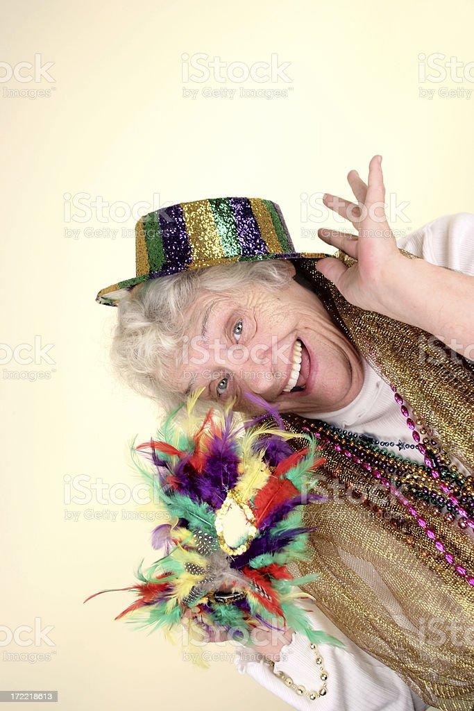 Photo of happy, fun grandma dressed in Mardi Gras costume stock photo