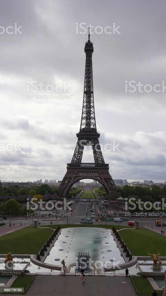 Photo of iconic Eiffel Tower in Champ de Mars as seen from Trocadero Gardens on a cloudy spring morning, Paris, France stock photo