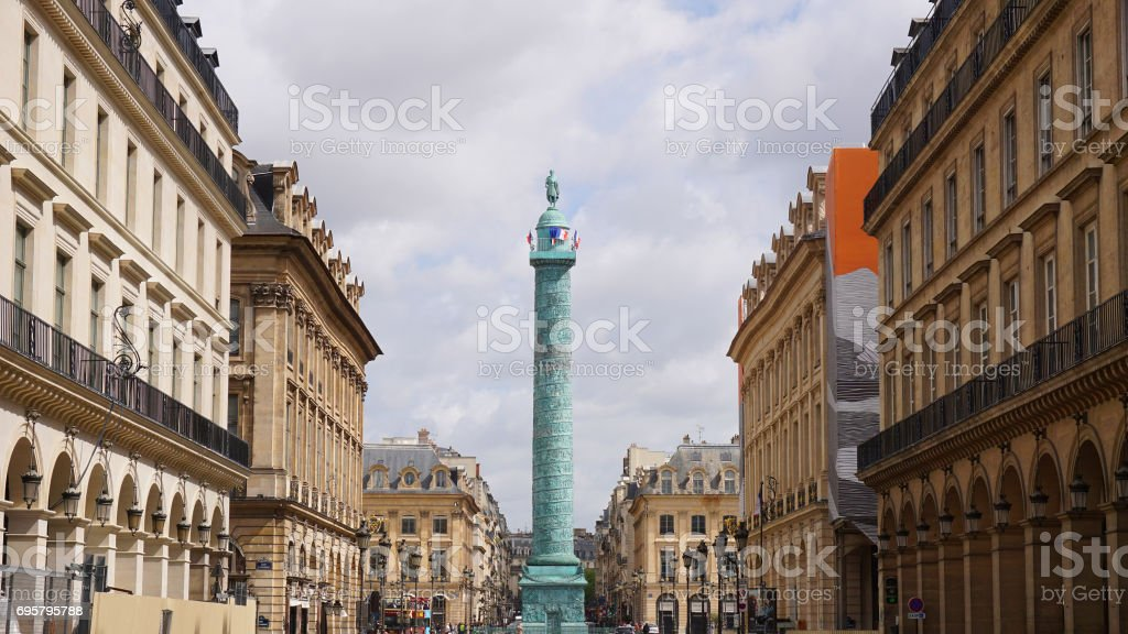 Photo of iconic Vendome column on a cloudy spring morning, Place Vendome, Paris, France stock photo