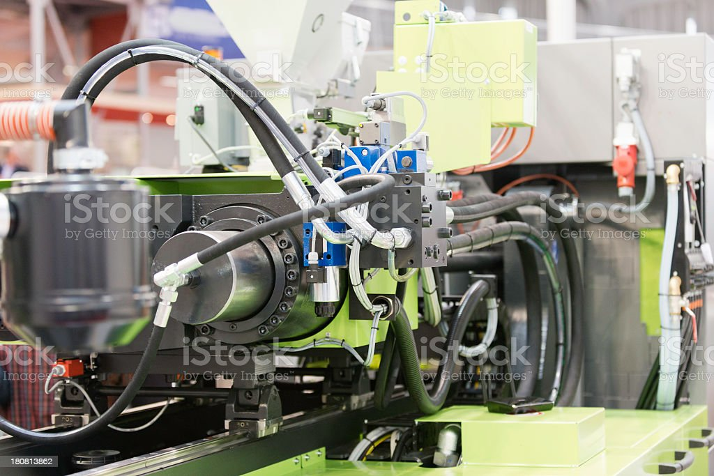 Photo of industrial plastic injection molding machine stock photo