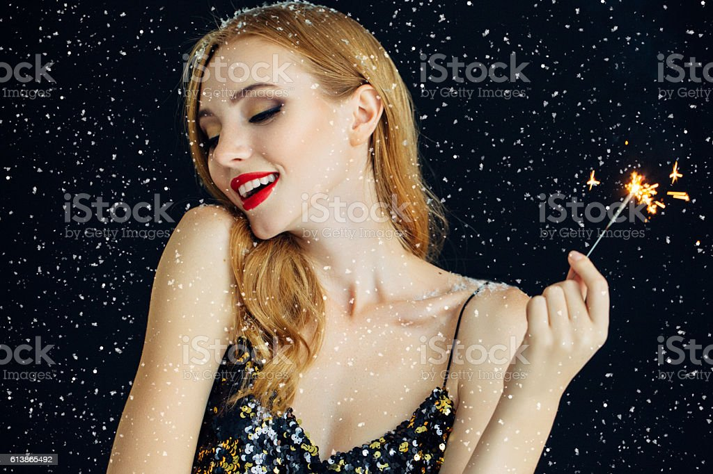 Photo of laughing girl strewn snow stock photo