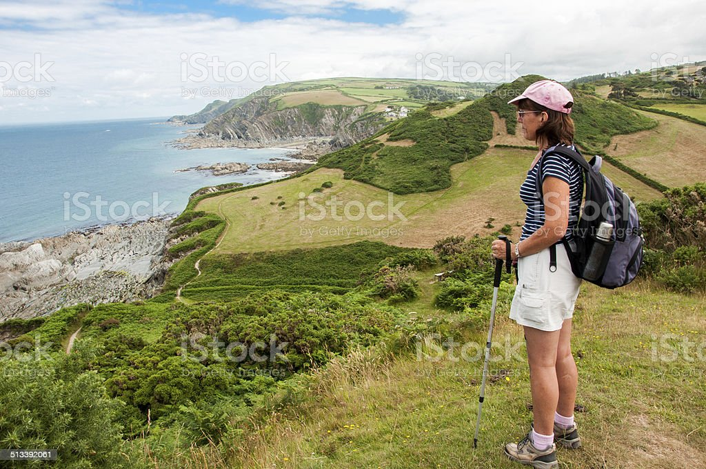 Photo of Lee Bay viewed by Woman Hiker Devon England stock photo