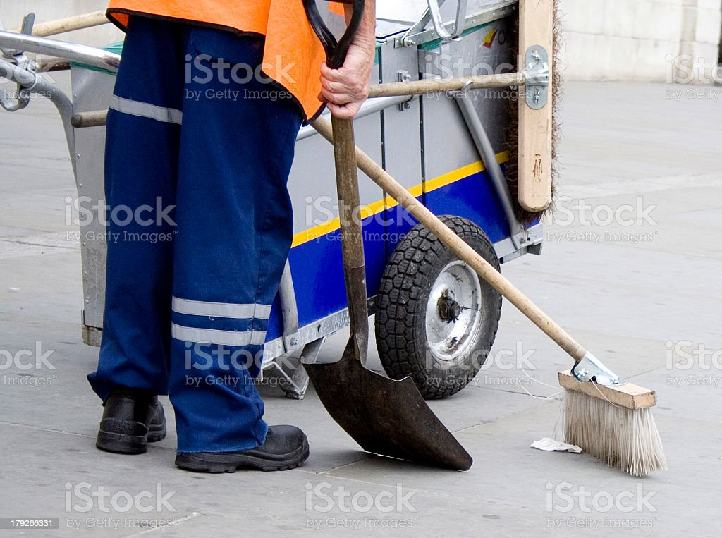 Photo of man in uniform cleaning street stock photo