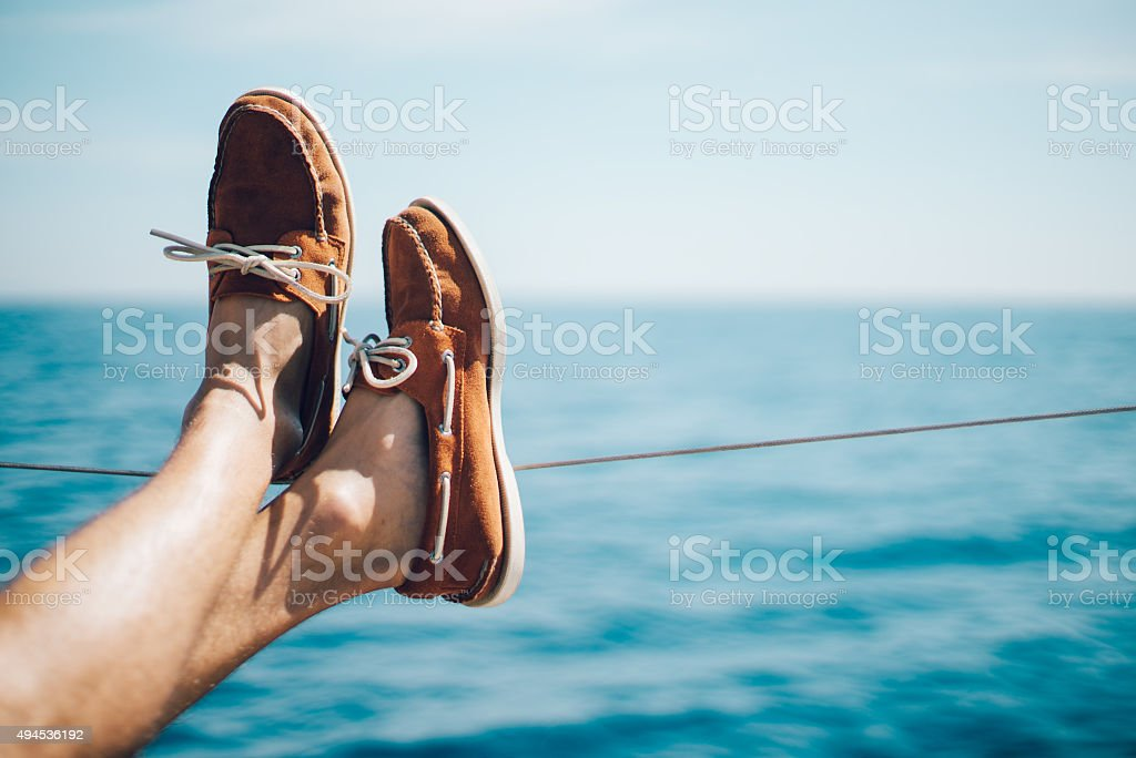 Photo of man legs on the yacht and wearing boat stock photo