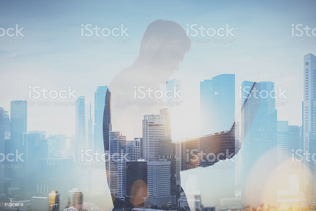 Photo of man working with laptop. Generic design laptop holding stock photo