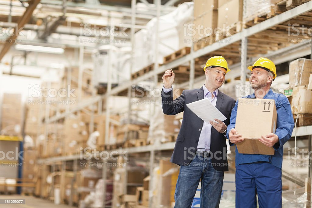Photo of manager and worker in warehouse royalty-free stock photo