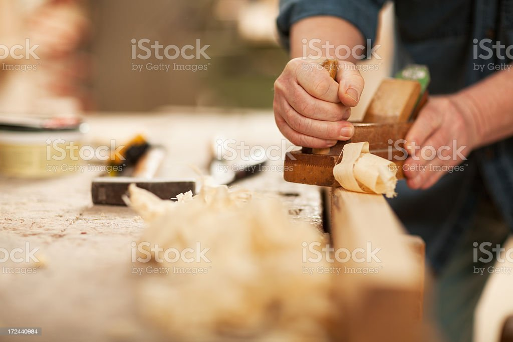 Photo of mature male hands of carpenter at work stock photo