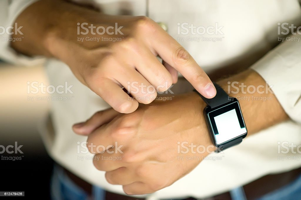 Photo of Mature man  Enjoying Generic Design Smart Watch stock photo