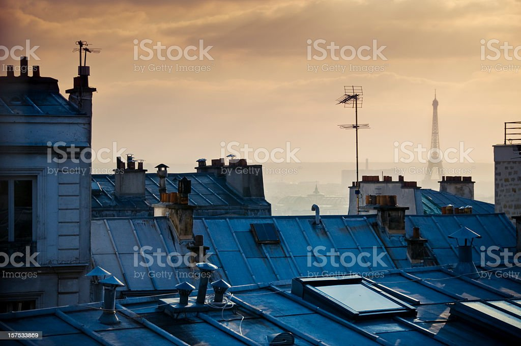 Photo of Parisian rooftops with Eiffel tower in background  stock photo