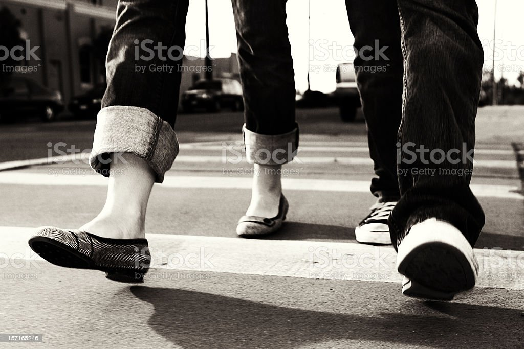 Photo of People Walking Across the Street royalty-free stock photo
