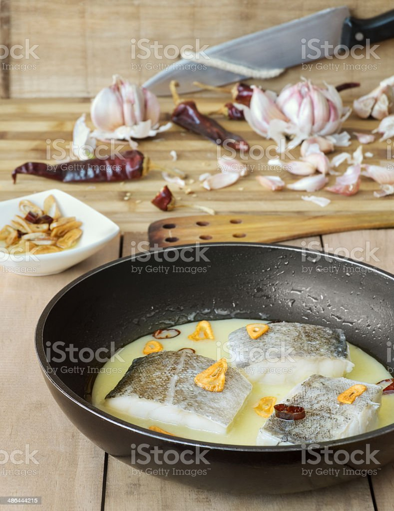 Photo of pil pili sauce on pan and chopping board stock photo