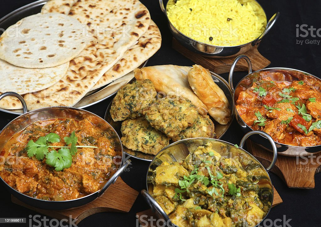 Photo of plates of different types of Indian food stock photo