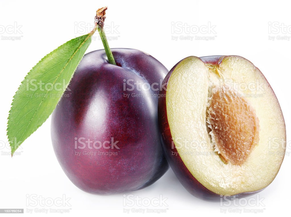 Photo of plum with leaf and one's half. royalty-free stock photo