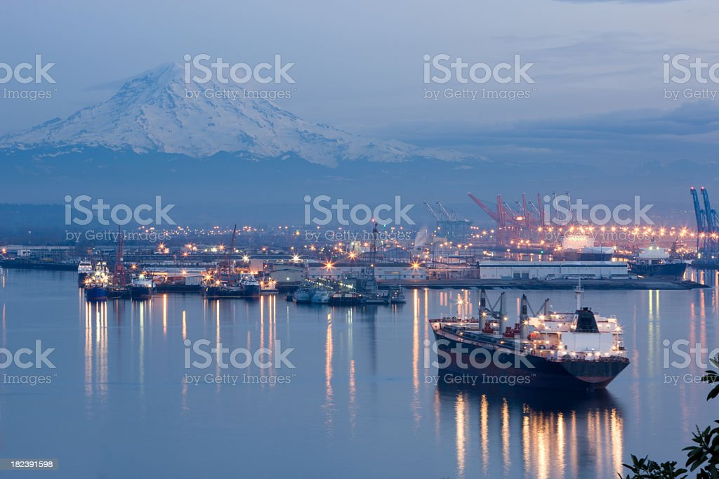 A photo of port Tacoma and a snow topped Mount Rainier stock photo