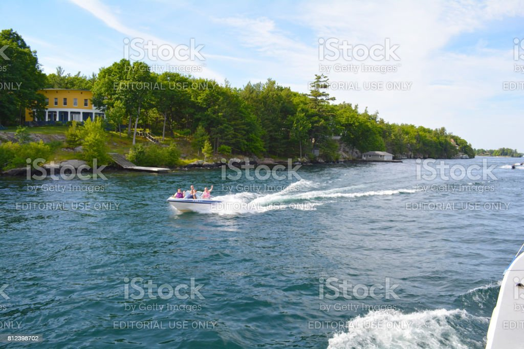 Photo of river boat on the St. Lawrence River. stock photo